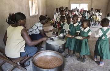 Children at the Konditi Primary School receive a hot meal at lunchtime.