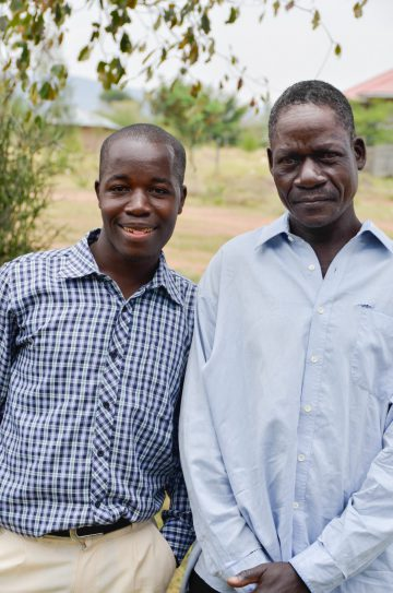 Our first scholarship student Calvin with his father. Calvin is now attending university!