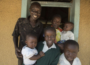 I-KODI board member and Women's Group Representative, Rosalind Owino with her family in Pap Onditi.